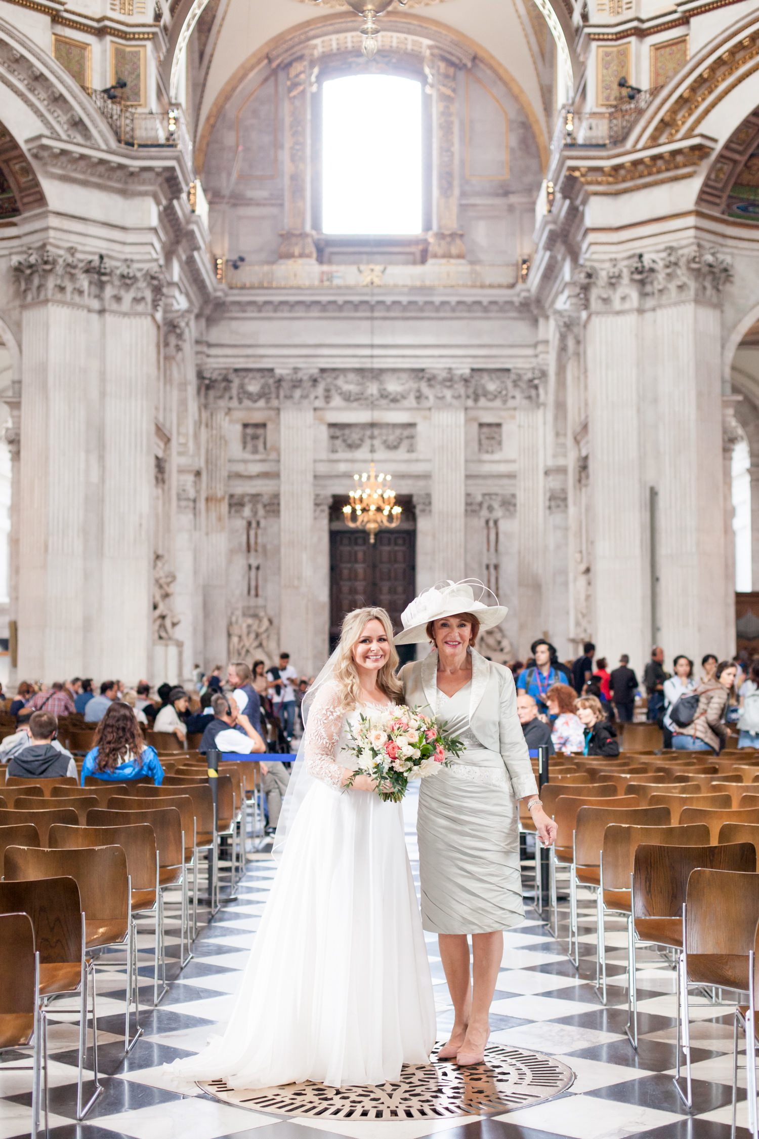 Charlotte & Adam's St. Paul's Cathedral wedding - a bride and her Mother inside St. Paul's cathedral