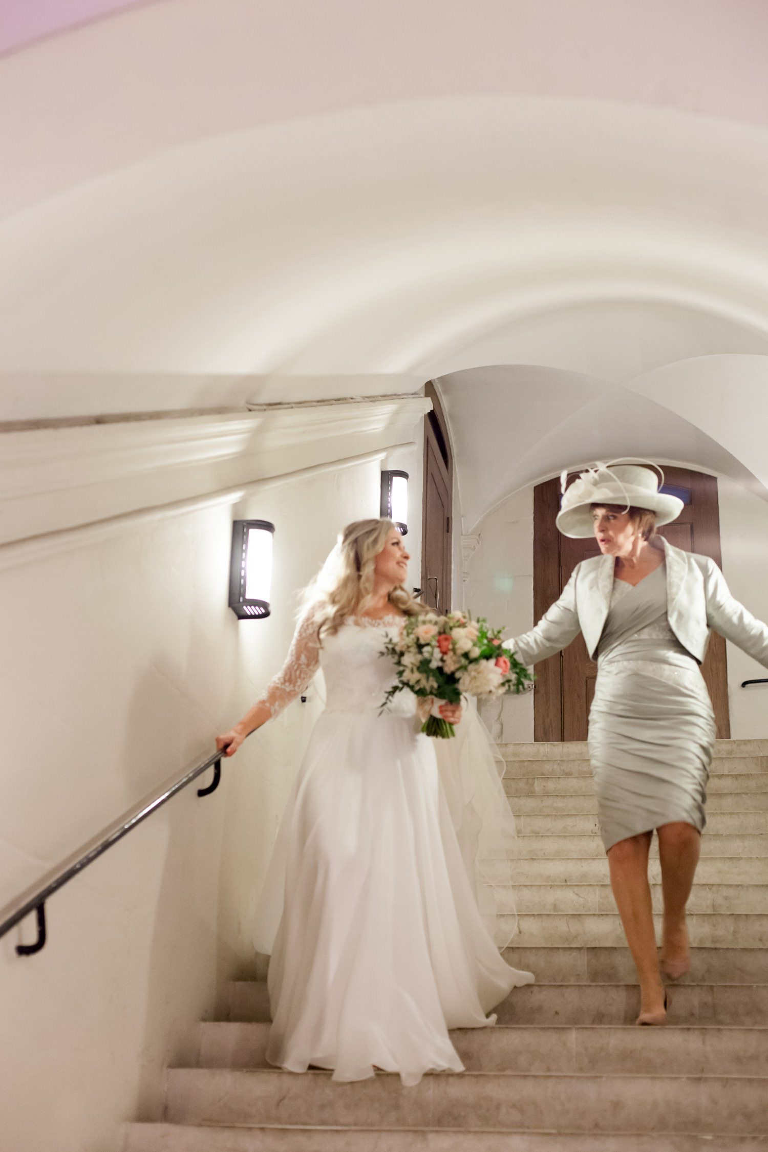 Charlotte & Adam's St. Paul's Cathedral wedding - a bride walks down the steps to the chapel