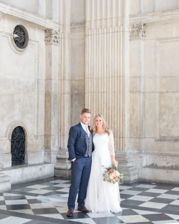 romantic wedding photography- a bride and groom at the porch at St. Paul's Cathedral