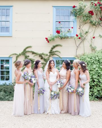 romantic wedding photography- a bride and her bridesmaids posing at a pastel wedding