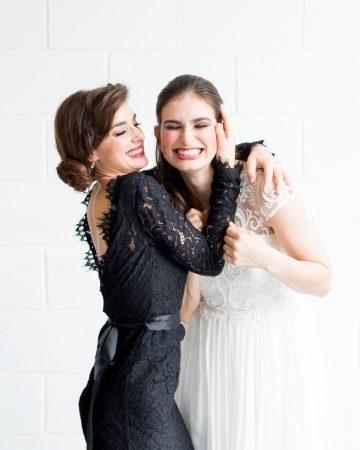 romantic wedding photography- a bridesmaid kisses her bride