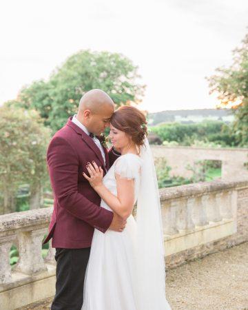 romantic wedding photography- a bride and groom embrace on an italian terrace