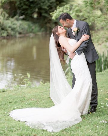 romantic wedding photography- a groom sweeps his bride back for a kiss