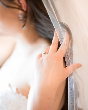 romantic wedding photography- a bride touching her veil
