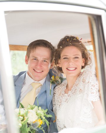 romantic wedding photography- a bride and groom in a their wedding car