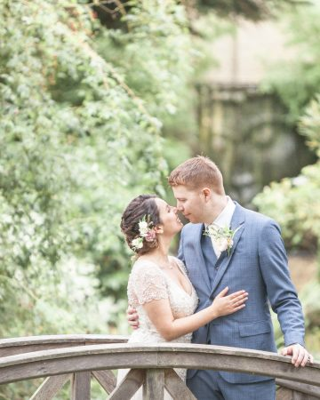 romantic wedding photography- a bride and groom at the bridge at South Farm