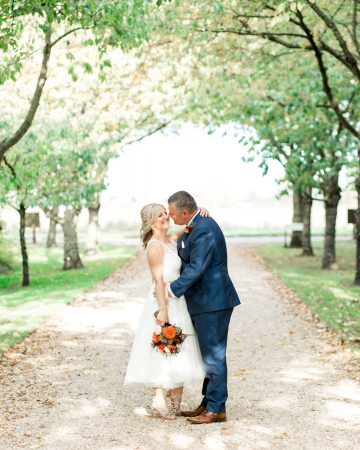 romantic wedding photography- a bride and groom at the driveway at South Farm