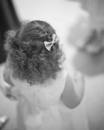 romantic wedding photography- a flower girl with curly hair