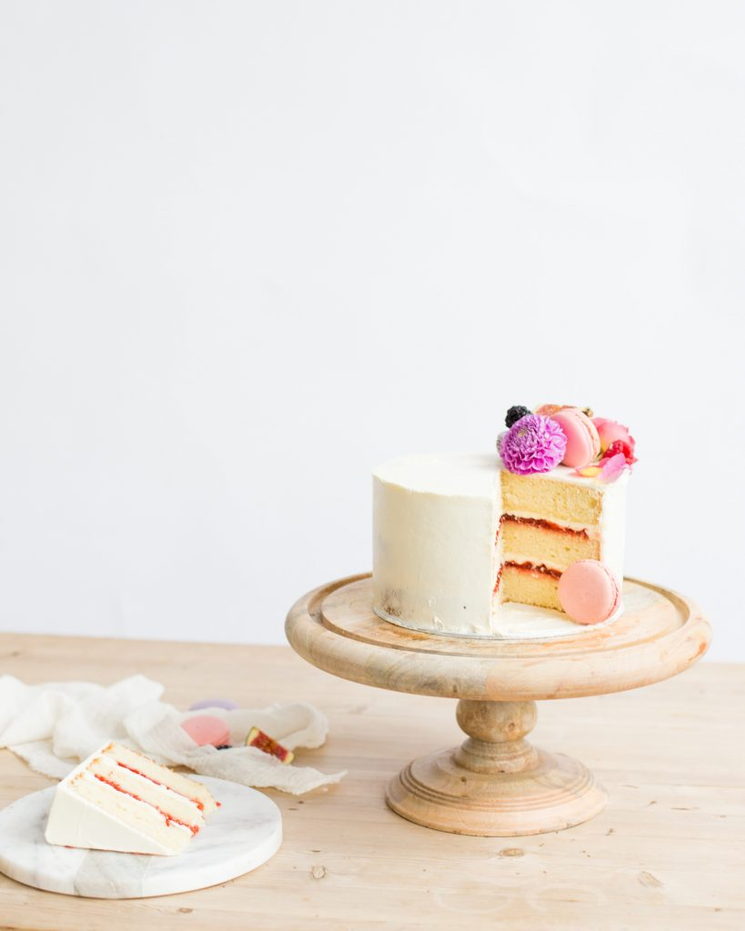branding shoot for Milk Street Kitchen - layered white cake on rustic stand
