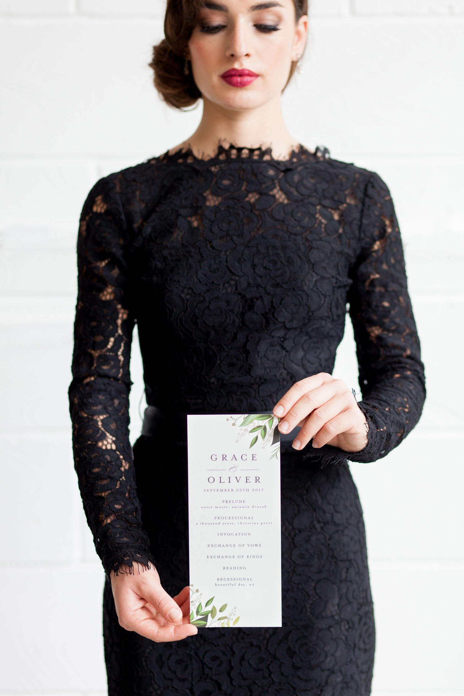 London Warehouse Wedding 1 - bridesmaid holds a wedding invitation