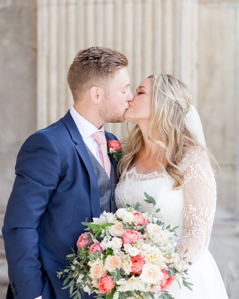 Charlotte & Adam's St. Paul's Cathedral wedding - a couple kiss