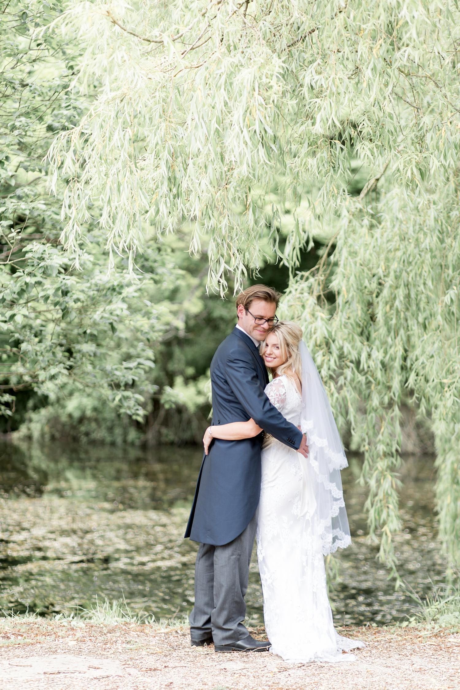 Emily & Jonathan's Cambridgeshire wedding - couple standing under weeping willow