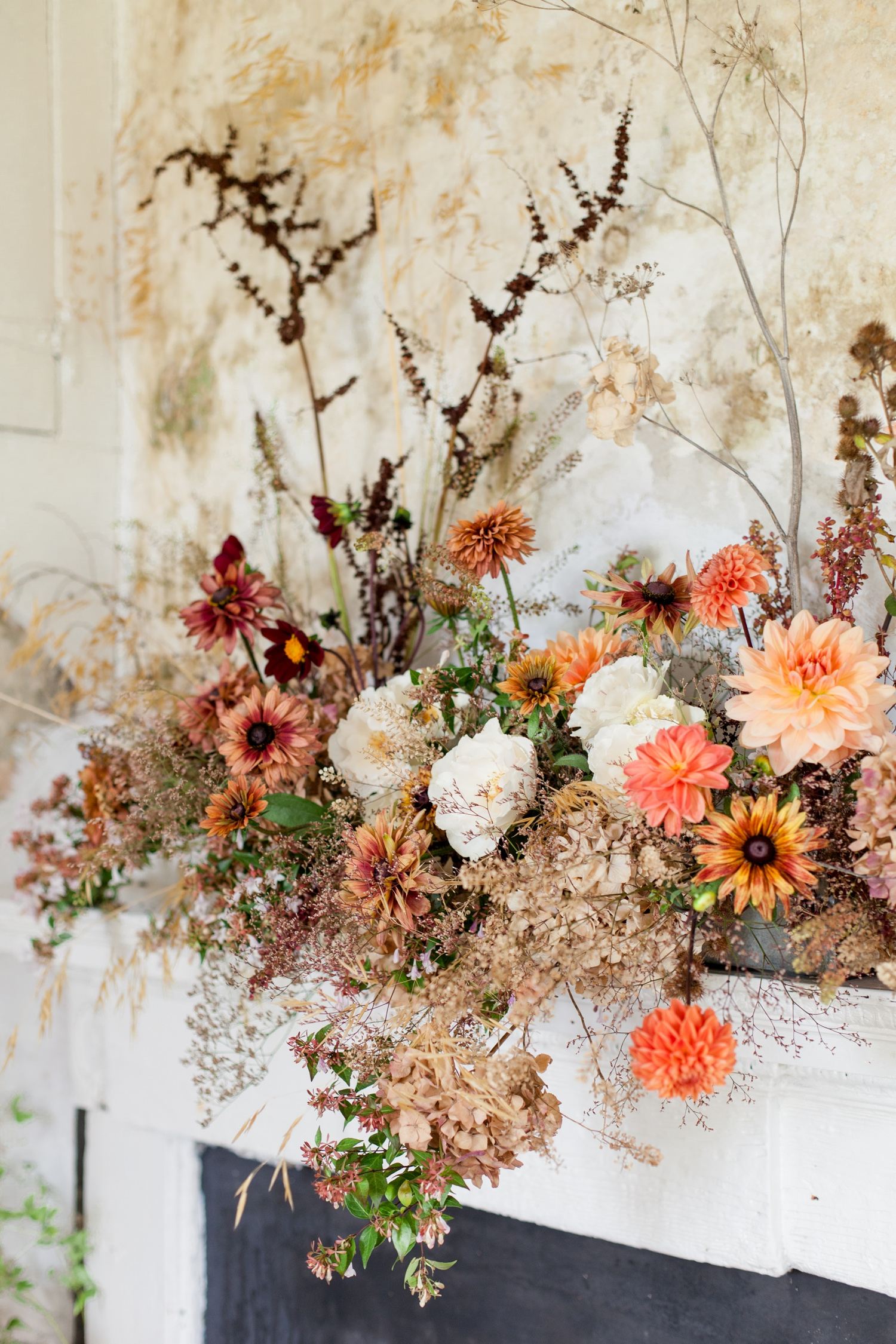 Wild and Romantic Wedding Flowers, an Autumnal mantlepiece arrangement