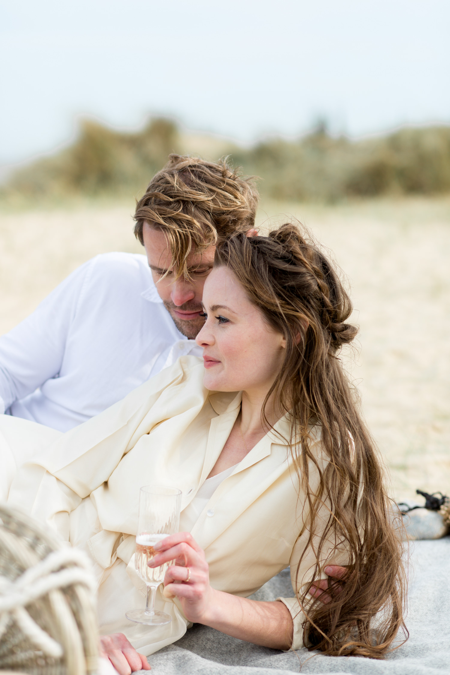 Comfortable In Front of the Camera on Your Wedding Day - a couple spending time together on a beach