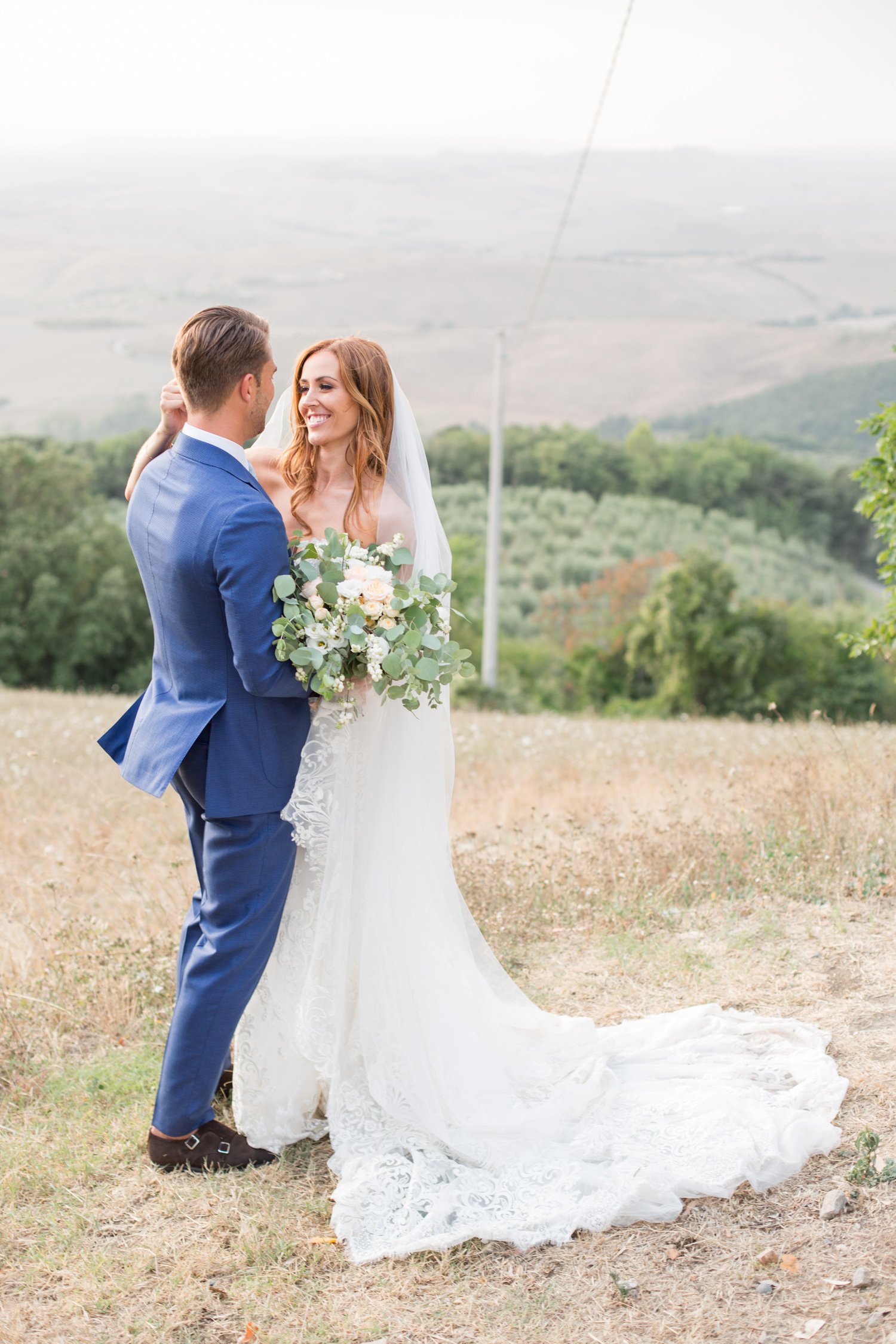 Comfortable In Front of the Camera on Your Wedding Day - a bride and groom portrait on a Tuscan hill